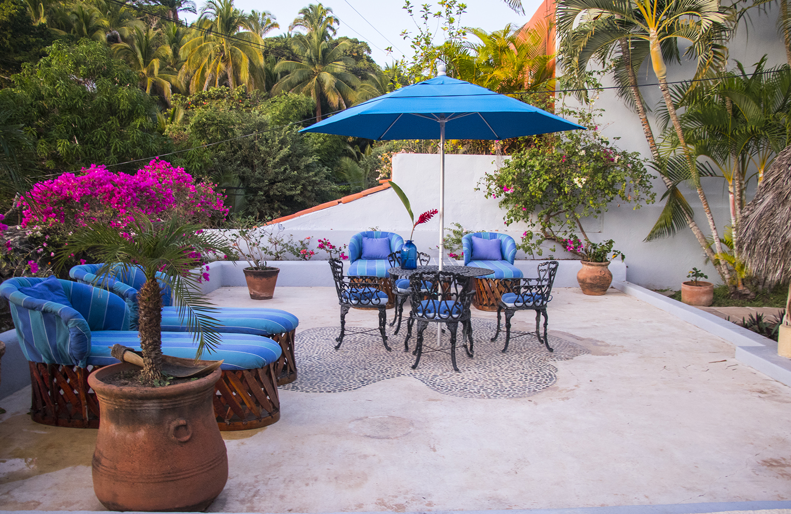Patio area next to the pool at our stunning vacation rental property in San Pancho, Mexico